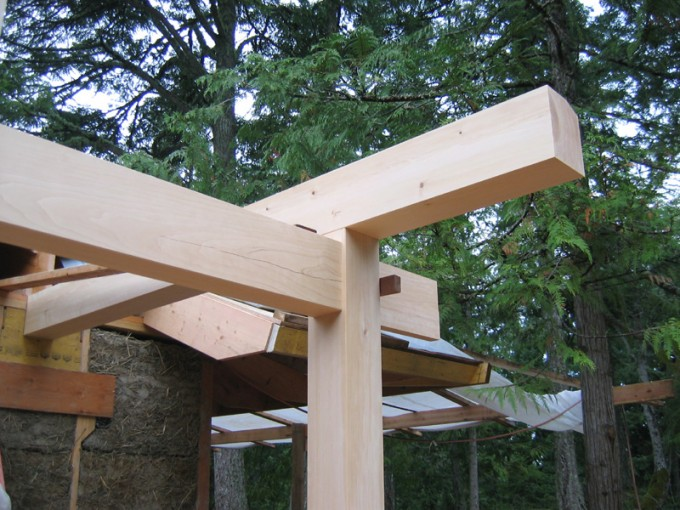The First Roof Beam Is Installed In A Front Porch For A Light Clay/fibre  Home. Rafters Will Sit On Two Roof Beams And A Ridge Beam As The Base Of  The ...